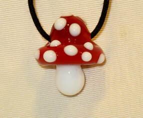Glass mushroom necklace by Jon Murray